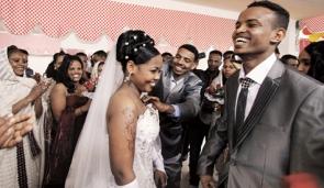 Jamal Yohans and Amleset Tesfaldet during their wedding reception. Photo by: Alex Levac